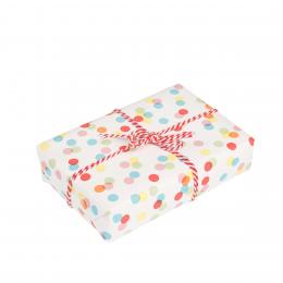 Feuille de papier cadeau à pois colorés